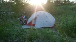 Riverside camping as the sun goes down