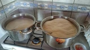 Heating the fresh milk to make cheese at Girdev