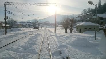 Winter sun on the snowy tracks