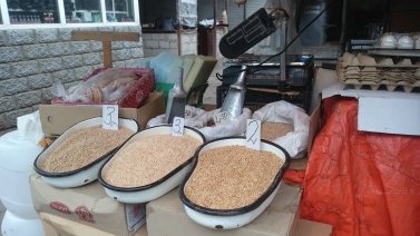 Bed pans full of grain at Sam Gori market