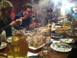 Steaming khinkali and jugs of wine amid the birthday feast